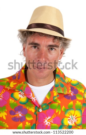 Portrait of typical tourist with colorful shirt and straw hat