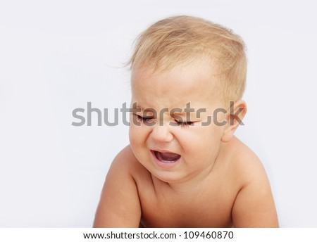 portrait of unhappy baby child isolated over white