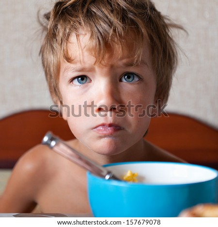 Portrait of unhappy child, not eating - stock photo