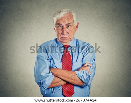Portrait of unhappy grumpy pissed off senior mature man isolated on gray wall background. Negative human emotions, face expression feelings  - stock photo