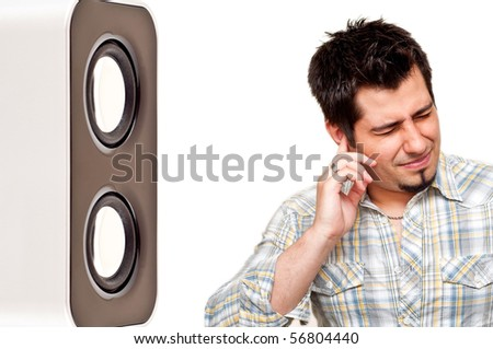 portrait of unhappy man plugging his ear from noise - stock photo
