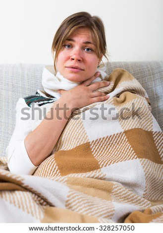 Portrait of unhappy woman suffering of sore throat and fever - stock photo
