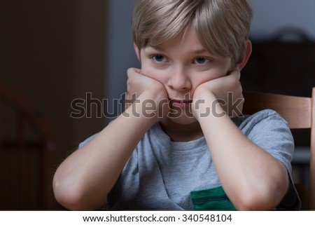 Portrait of unhappy young boy - horizontal view - stock photo