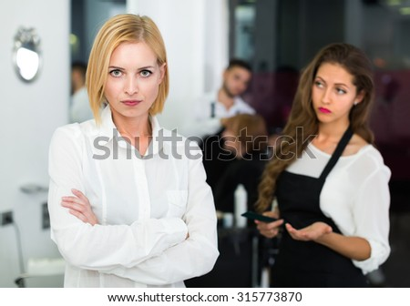 Portrait of unhappy young female at the hairdressing salon  - stock photo