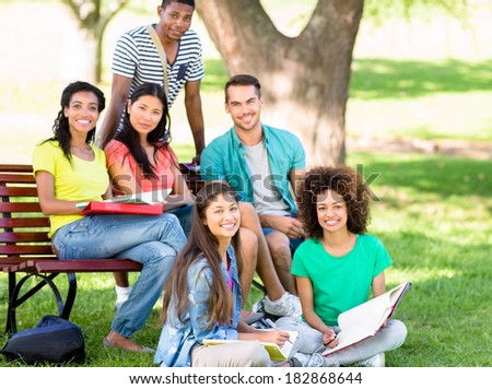 Portrait of university students studying at college campus