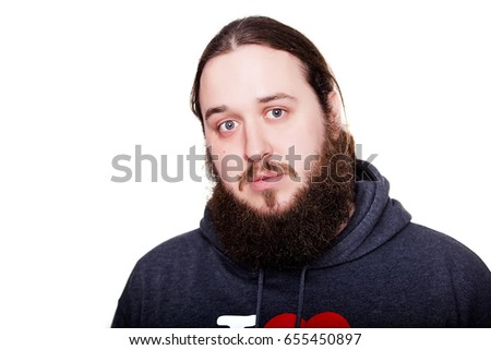 Portrait of unshaven man in blue jumper with long beard and looking forward standing on white background, horizontal picture