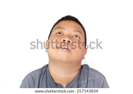 Portrait of upset boy  on white background - stock photo
