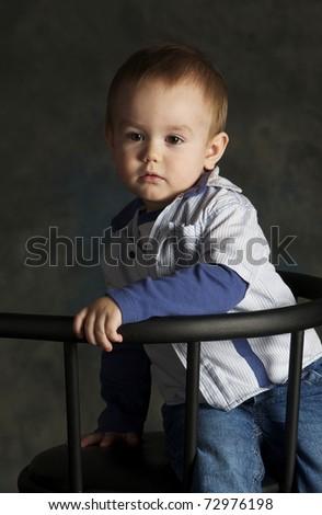 Portrait of upset little boy, studio sho - stock photo