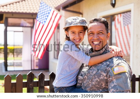 portrait of us army soldier and little daughter outside their home - stock photo