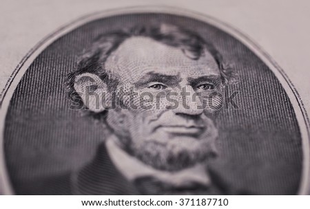 Portrait of US President Abraham Lincoln on the five dollar bill series 1995 , background of the money, five dollar bills front side obverse. background of dollars, close up