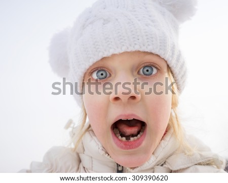 Portrait of very frightened young girl screaming in open air, in state of shock - stock photo