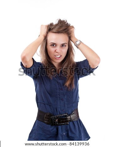 Portrait of very frustrated and angry mad woman pulling her hair against white background - stock photo