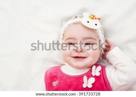 Portrait of very sweet little child 5 month old baby girl - stock photo