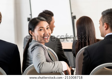 Portrait of Vietnamese business lady attending meeting
