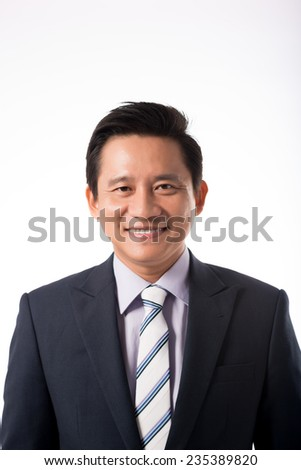 Portrait of Vietnamese businessman looking at the camera - stock photo