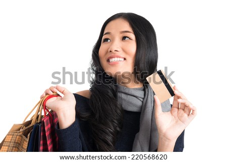 Portrait of Vietnamese woman with paper bags and credit card - stock photo