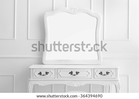 portrait of vintage vanity table set with three drawers and mirror
