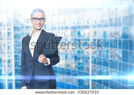 Portrait of wearing glasses business woman who hands black folder, blue background. Concept of leadership and success - stock photo
