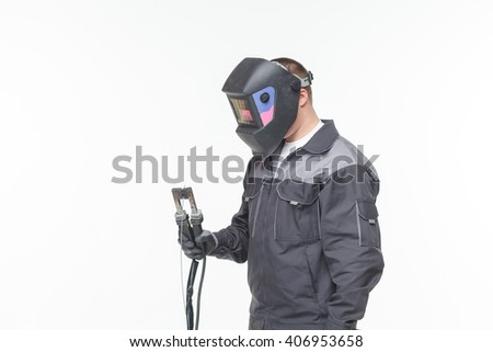 Portrait of welder in mask isolated on white background - stock photo