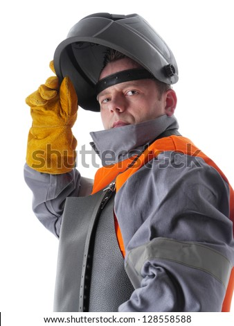 Portrait of welder wearing protective suit and welding hood on white - stock photo