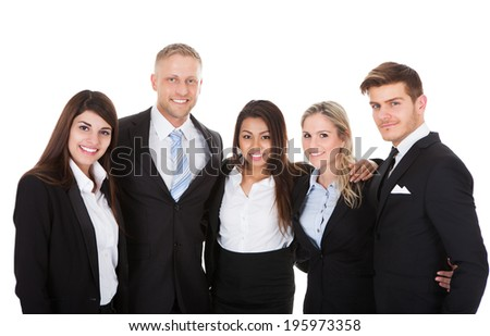 Portrait of welldressed businesspeople standing together against white background
