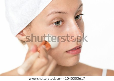 Portrait of white woman doing her daily makeup routine