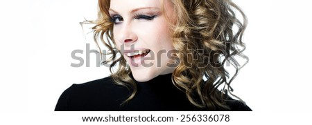 Portrait of winking girl. Young beautiful smiling and give a wink - stock photo