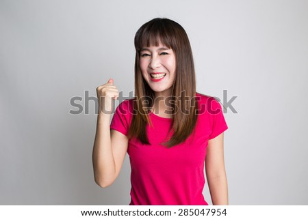 Portrait of winning success ecstatic woman - stock photo