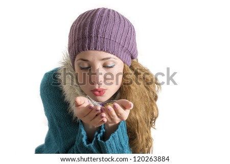 Portrait of winter girl holding some Christmas decorations - stock photo