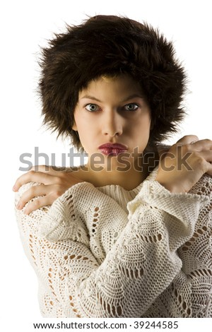 portrait of winter woman with white sweater and brown fur hat looking strong in camera - stock photo