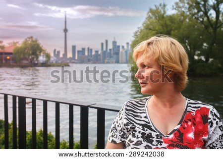 Portrait of woman against the backdrop of the city - stock photo