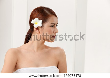 Portrait of woman against white background.