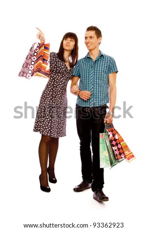 Portrait of woman anb man  holding color shopping bags , isolated on white background