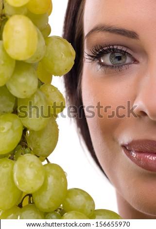 portrait of woman and fresh green grapes