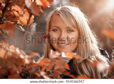 Portrait of woman at autumn