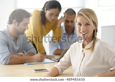 Portrait of woman attending work meeting