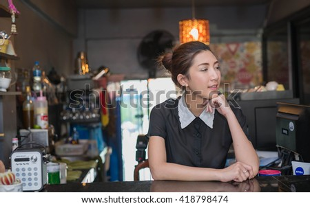 Portrait of woman barista (owner business) in the coffee shop