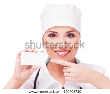 portrait of woman doctor with a business card, isolated on white background - stock photo
