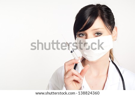 portrait of woman doctor with a syringe, isolated on white background - stock photo