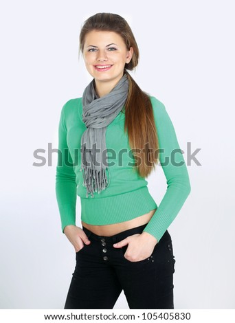 Portrait of  woman dressed in a green blouse, Isolated on white background - stock photo