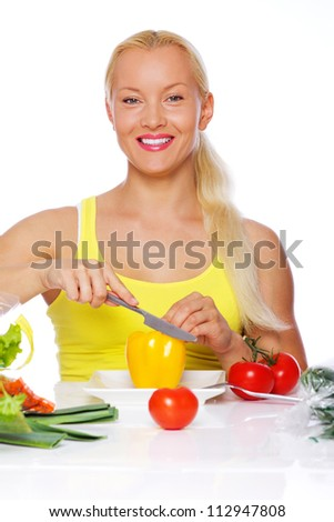 Portrait of  woman eating vegetables on the kitchen