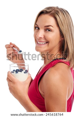 Portrait of Woman enjoying eating her yogurt and blueberries isolated on white background - stock photo