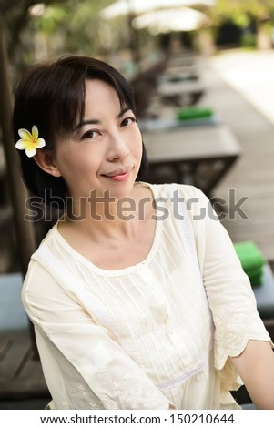 Portrait of woman enjoying outdoors on hotel