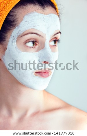 Portrait of woman having a sake and rice smoothing face mask - stock photo