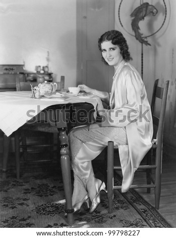 Portrait of woman having meal at table
