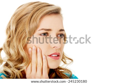 Portrait of woman having strong toothache. - stock photo