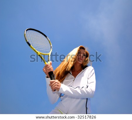 Portrait of  woman in  age of 40-45 years actively engaged in tennis