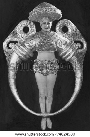 Portrait of woman in elaborate ring costume - stock photo