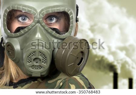 Portrait of woman in gas-mask - in toxic environment- pollution concept