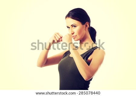 Portrait of woman in military clothes boxing to someone. - stock photo
